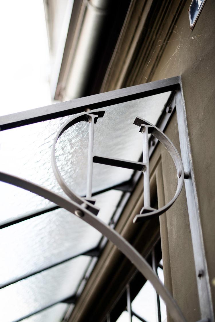 Hotel Central & Cafe metal logo framework