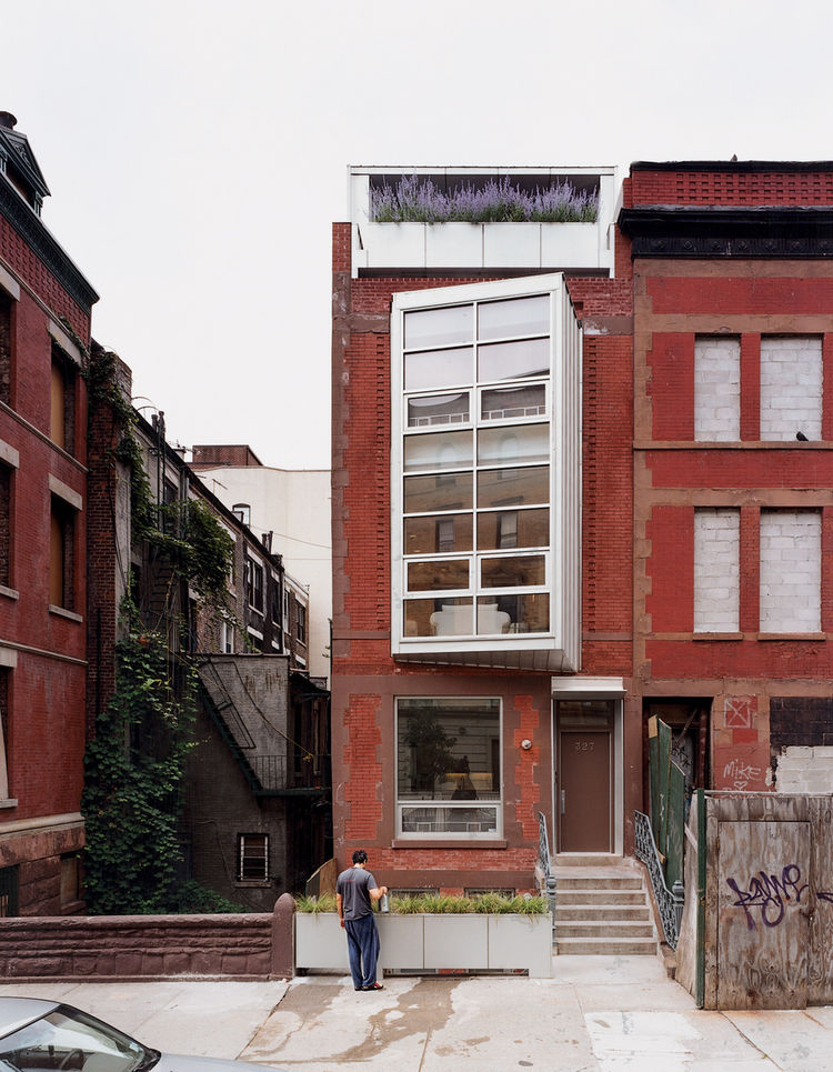 Narrow brick house in Harlem, New York.