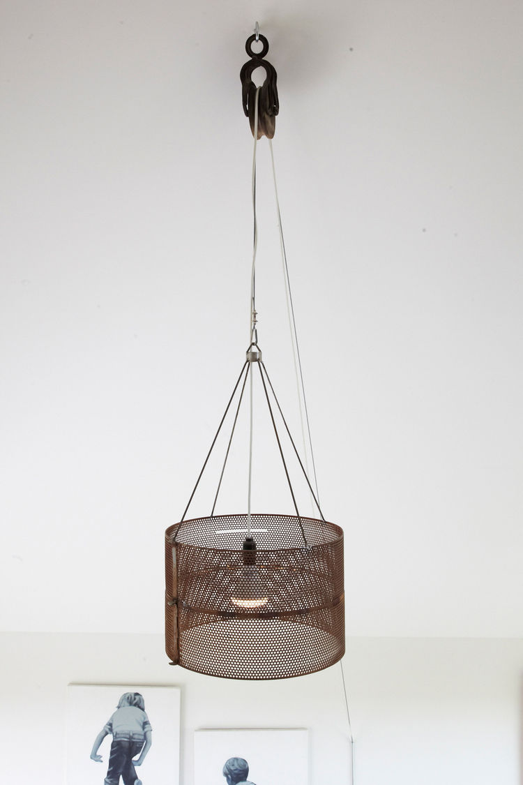 Modern hanging lighting fixture with adjustable cord