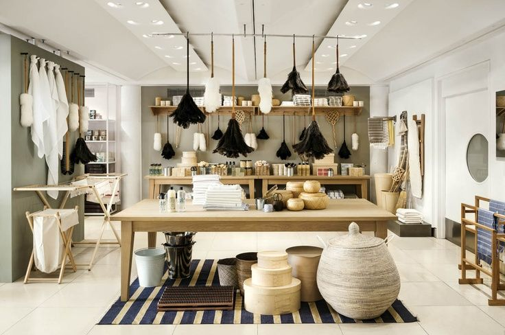 Kitchen and home goods at The Conran Shop include the Wardour dining table designed by Jasper Conran, plus waffle knit hand towels, ash wood laundry baskets and drying racks, and woven baskets.