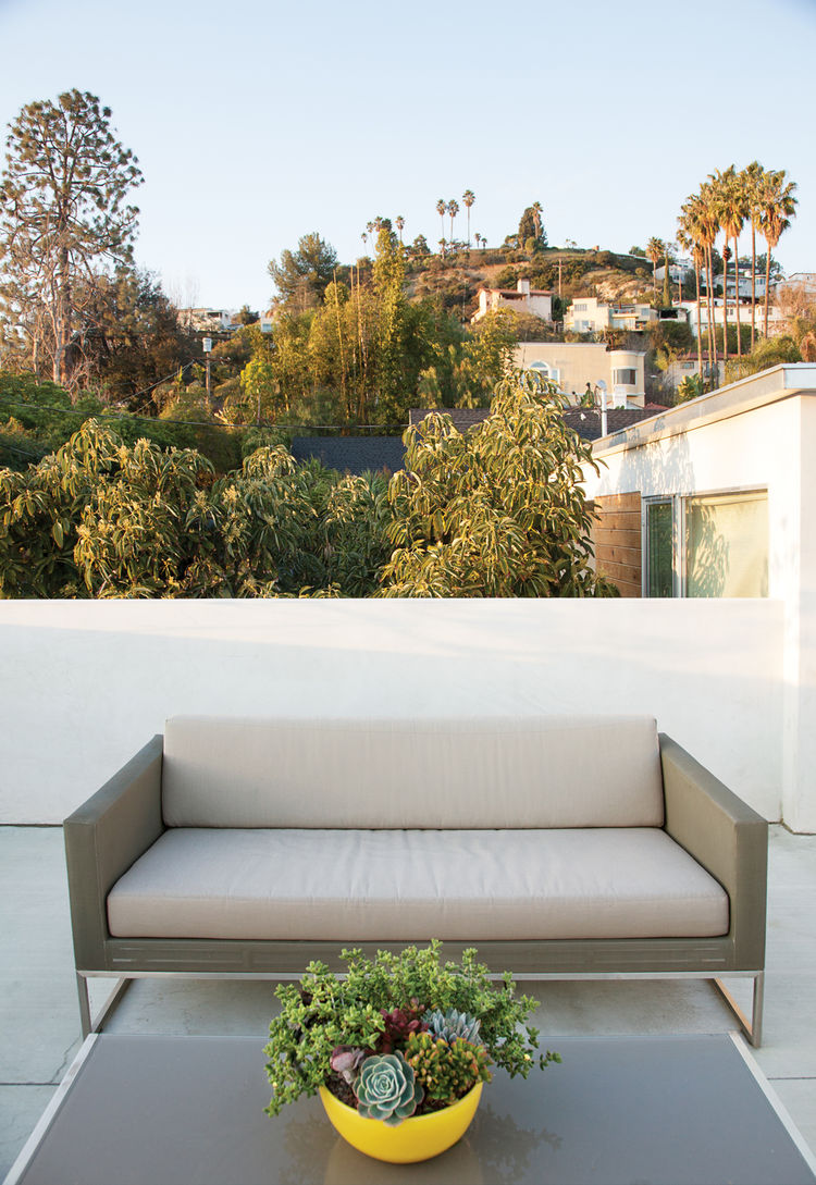 Rooftop deck with sofa.