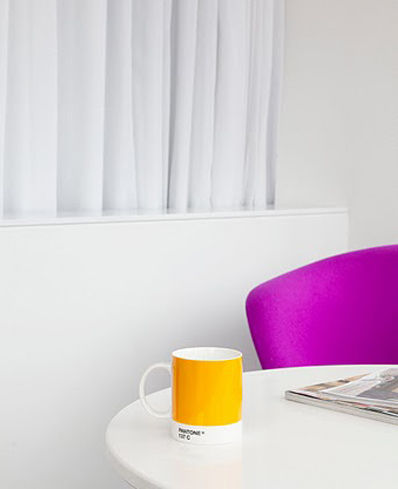 Bright mug and chair at Pantone hotel.