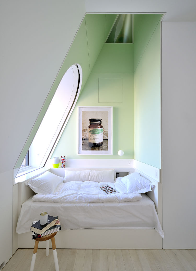 Architect David Hotson and interior designer Ghislaine Viñas designed the alcove attic bedroom in this four-story penthouse in New York City