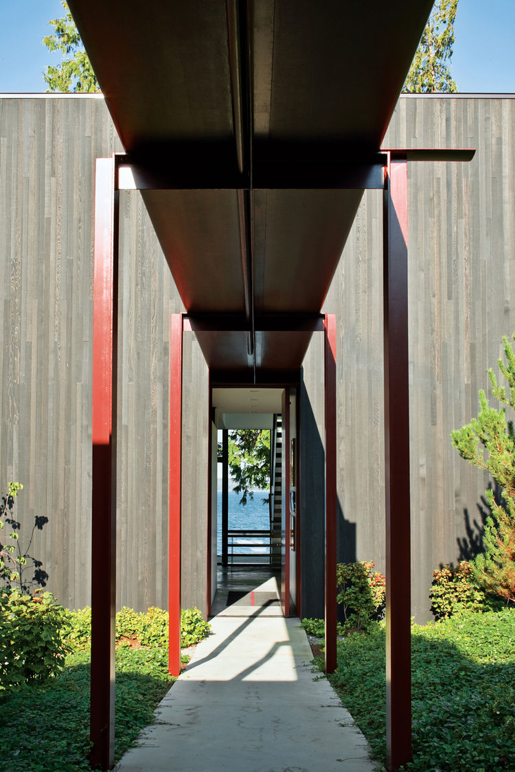 Red steel canopy covering walkway.