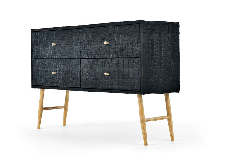 Blackened cabinet with ladder legs.