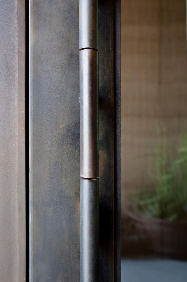 Door handle with vault-like opening mechanism.