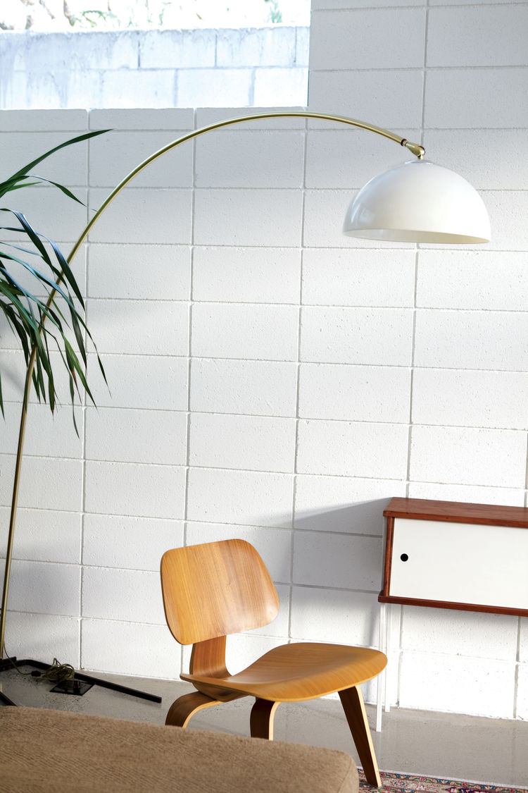 White floor lamp and wooden chair