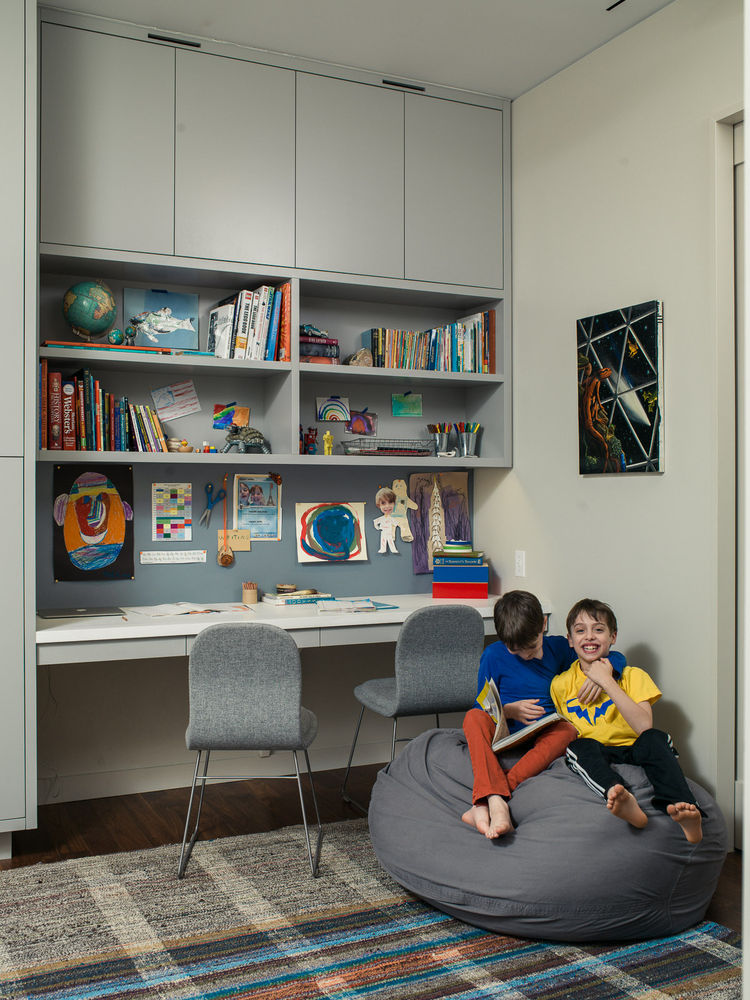 Cappellini desk chairs and a vintage kilim rug in the boy's playroom slash homework area