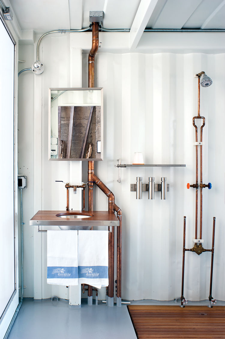 Industrial style bathroom with exposed copper piping