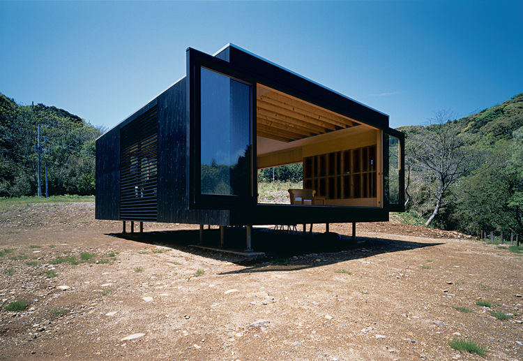 black box home in Japan open glass doors