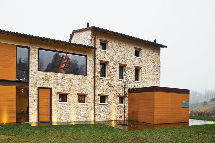 sandstone and teak facade of remodeled Italian house