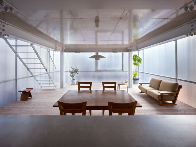 Luminescent walls and windows in the Hiroshima Japan modern family house by Suppose Design Office