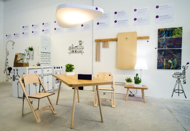 Folding furniture chair from Folditure, sound-absorbing ceiling light by Luceplan, flatpack tables from Studio Gorm