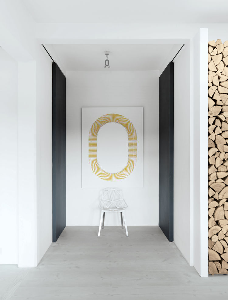 Modern bathroom hallway with hanging art