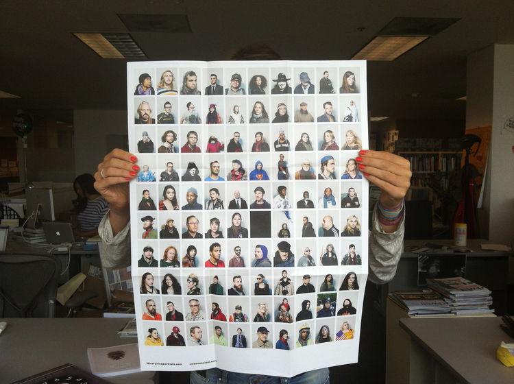 """Julia holding up a promo of the series """"Ninetynine"""" by João Canziani, showing us just how large this fold-out is. portrait, Zucotti Park, New York City, 2011 photography promotion marketing"""