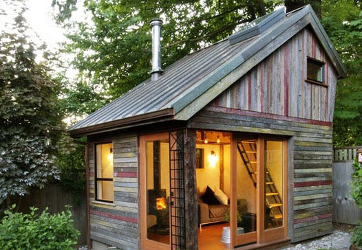 Tiny wooden outdoor cabin