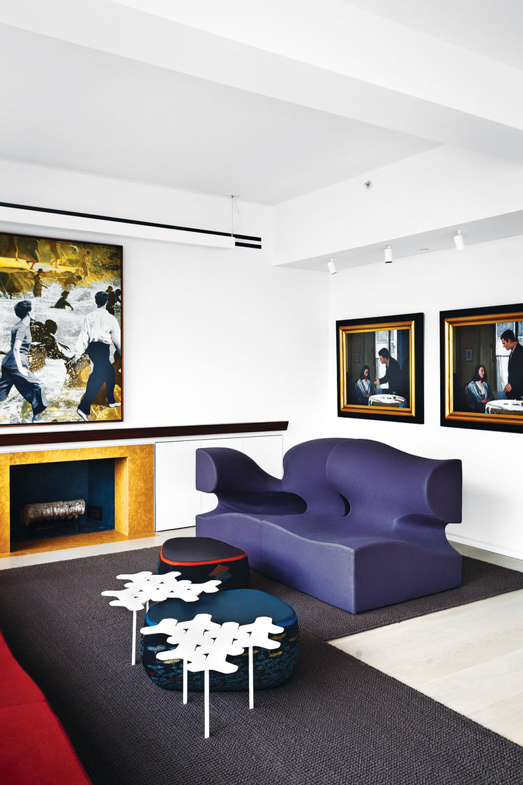Modern living room with purple sofa and artwork