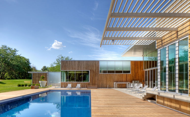 cedar-clad house with swimming pool