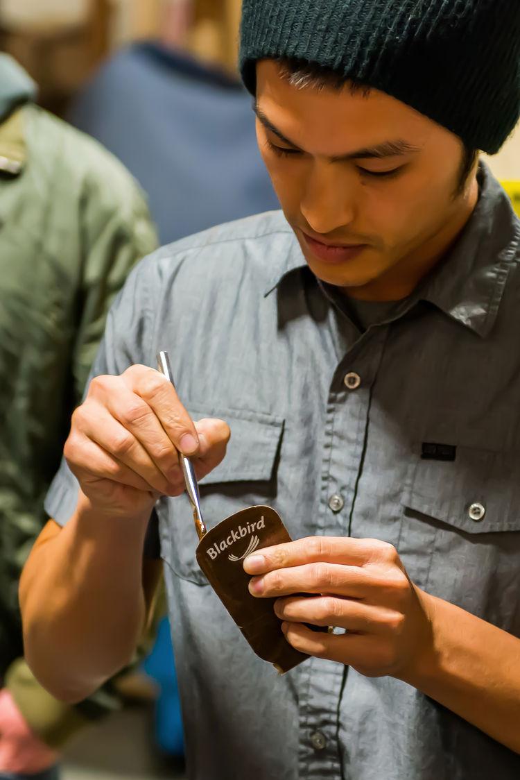 Jimmy Tran applying epoxy to the headplate.
