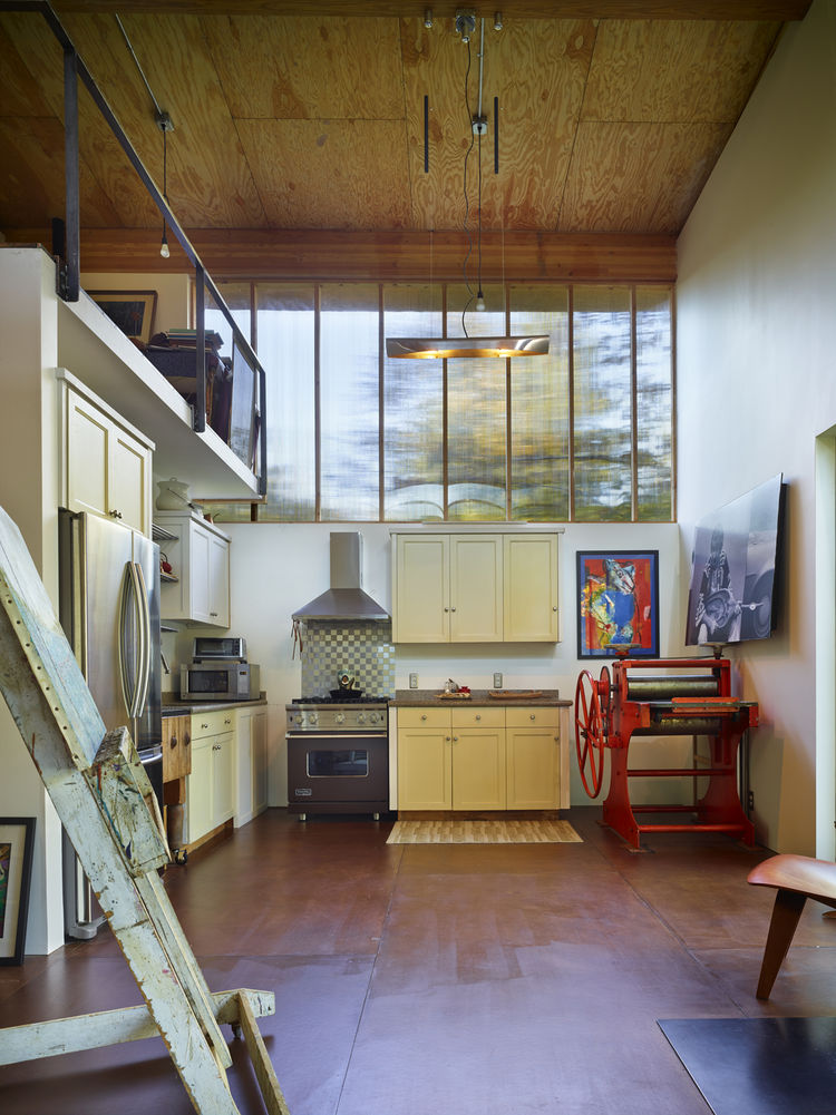 kitchen with salvaged cabinets in small house