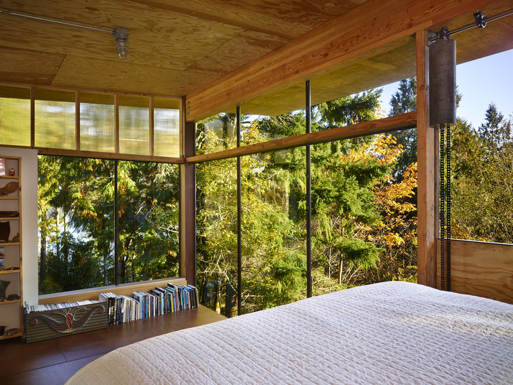 sleeping loft in compact cabin by olson kundig