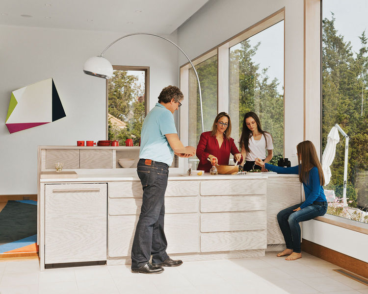 arctic white kitchen with exposed wood grain interior family portrait