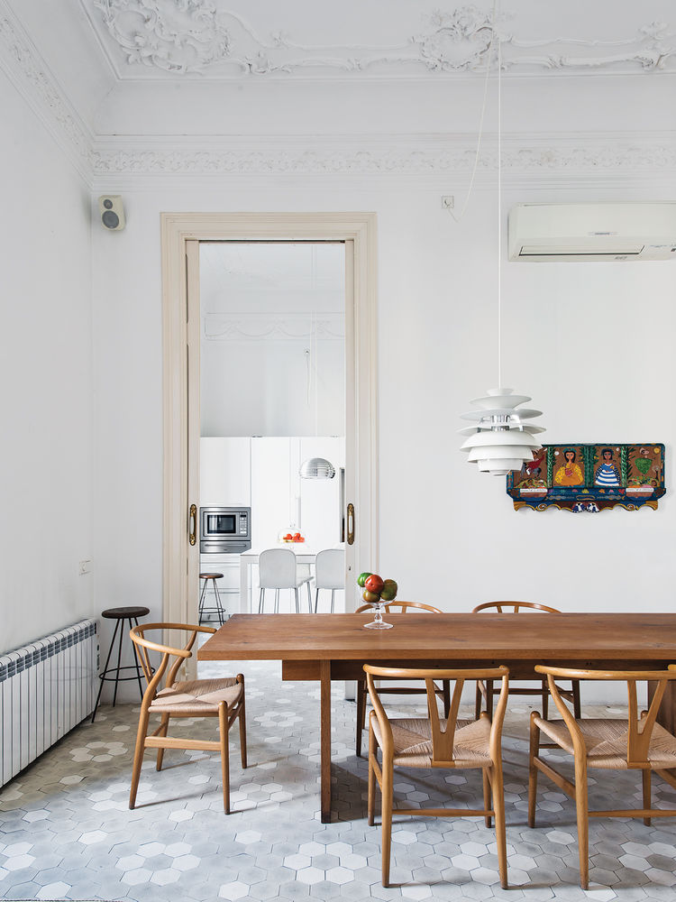 modern kithen with gray tile floor and wood dining table and chairs