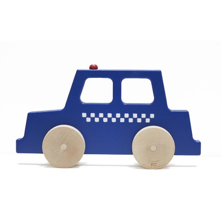 a minimalist wood police car figurine