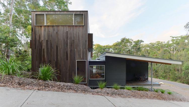 modern house with dark wood facade