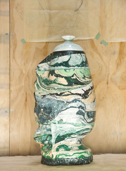 amorphous ceramic pot with lid in an elaborated mutlicolored glaze