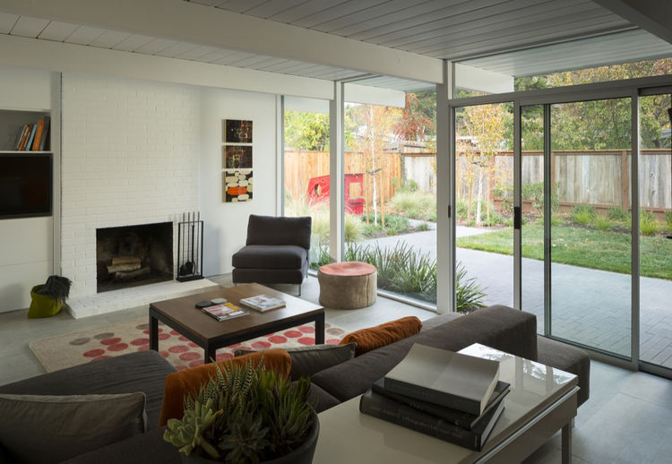 a view of the renovated home's living room by day