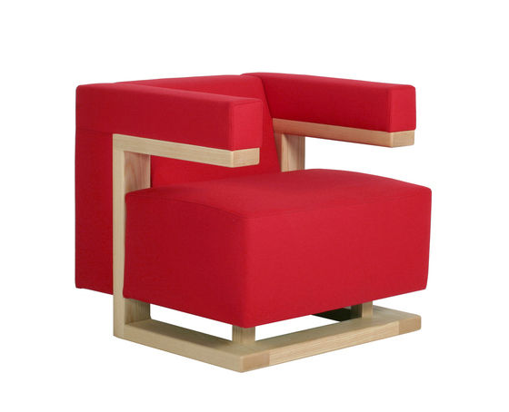a red armchair coated in fabric with a maple frame
