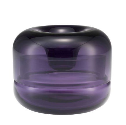 two overlapping mouth-blown glass piece form a candle holder