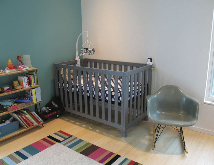 modern kids room with crib in prefab house by method homes