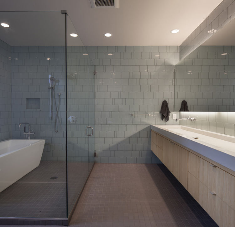 master bathroom with tile floors in modern prefab house