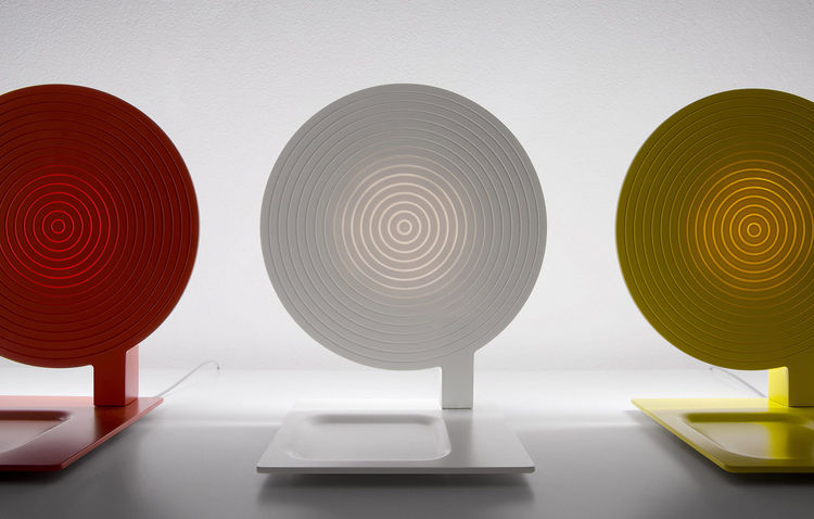 yellow white and red flat circular table lamps