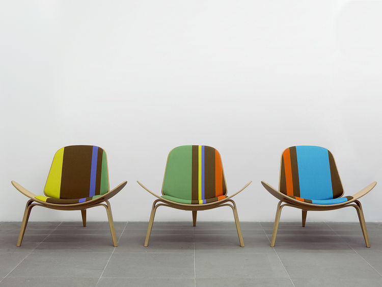 wood chairs with multicolored textile seats