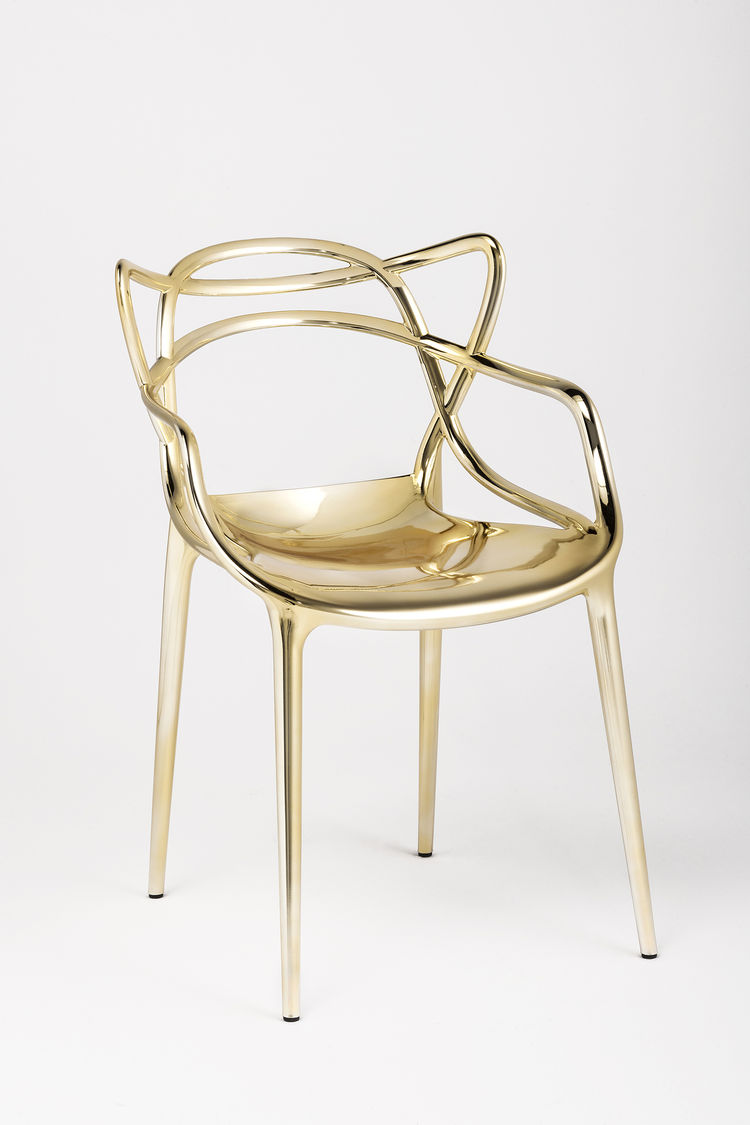 gold chair designed by Philippe Starck
