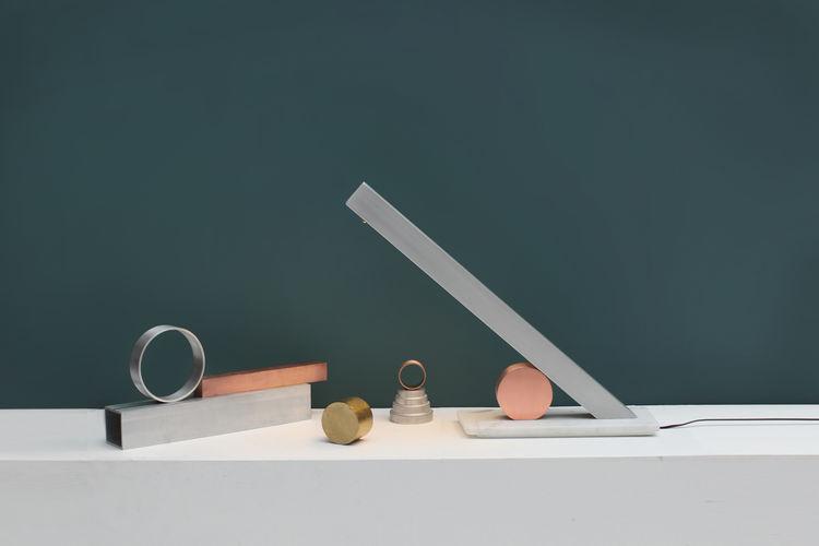 forward slash lamp inspired by sundial