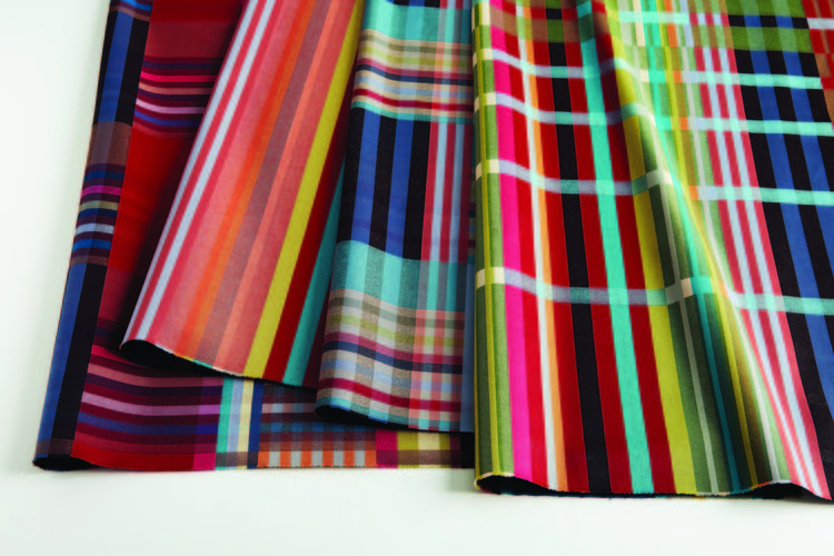 designtex piles of plaid textiles