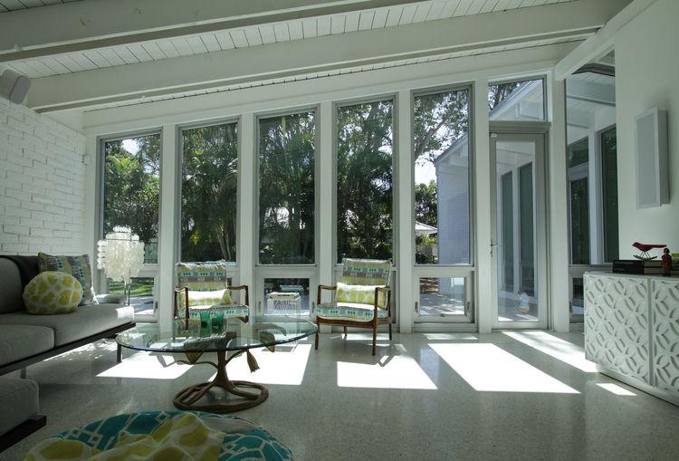 palm beach house living room with windows