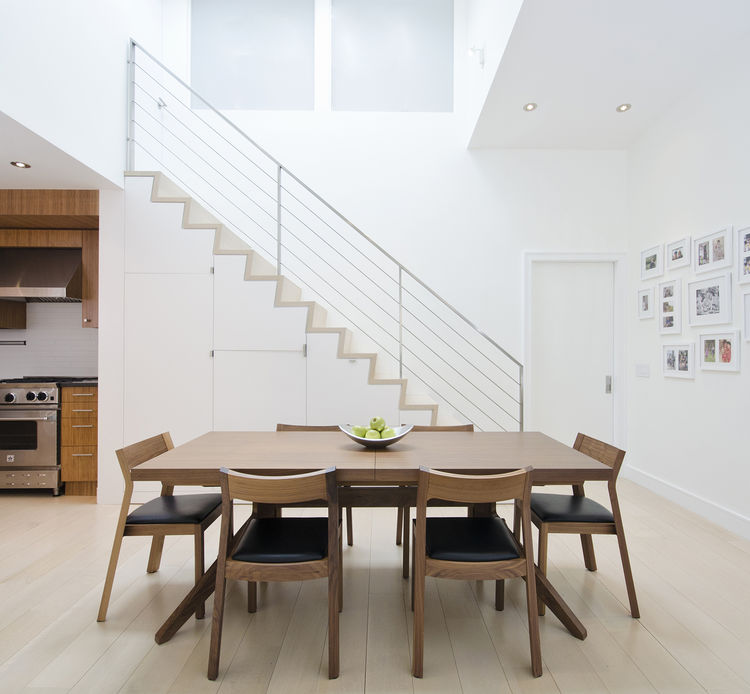 dining area with wood table and chairs and white walls