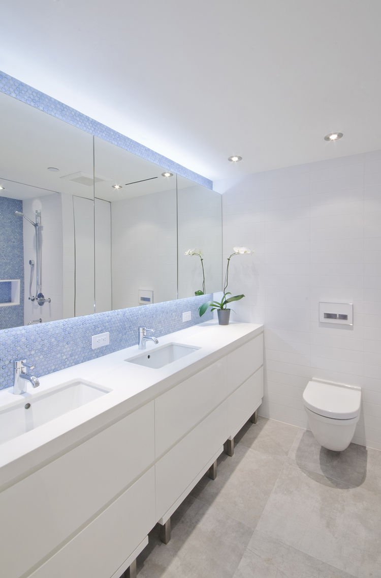 modern bathroom with penny  tile and white counters