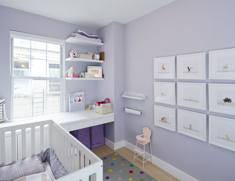 modern kids room with white crib and purple walls