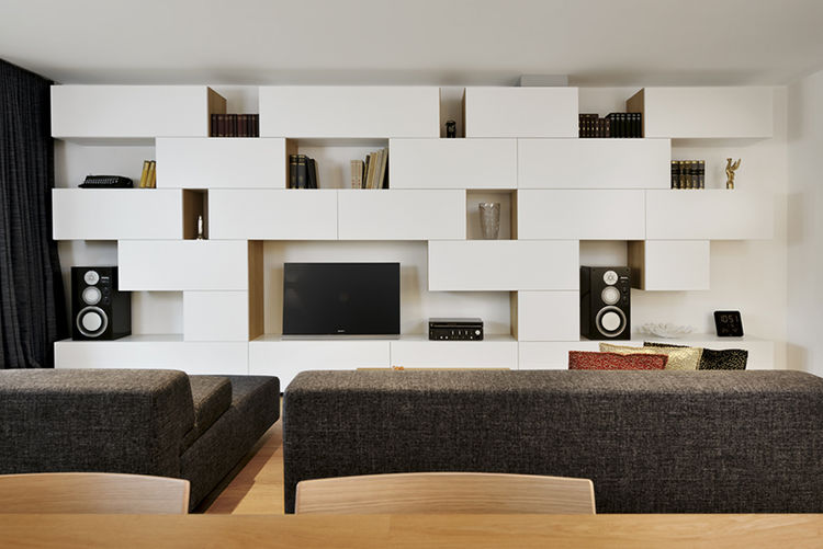 living room with white built-in shelves