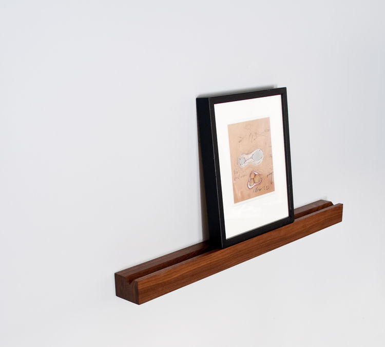 Wall-mounted rail-style box crafted from walnut, for holding framed photographs, prints, or postcards
