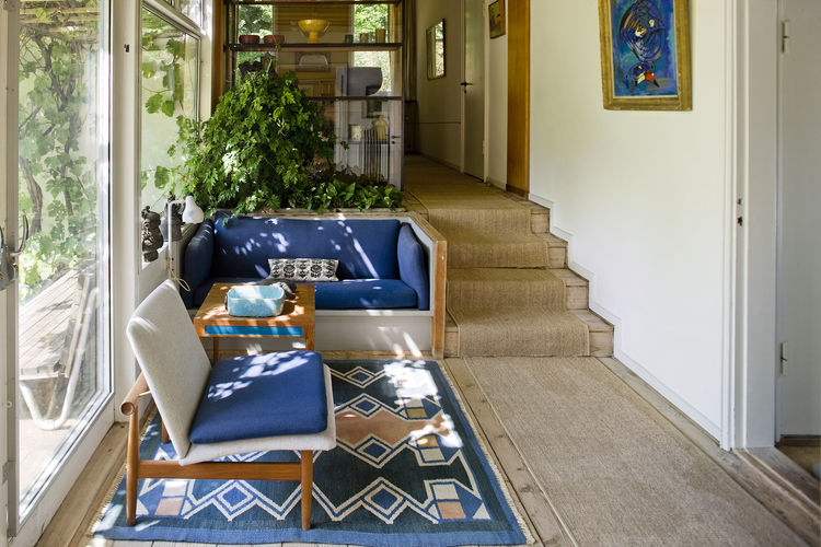 Finn Juhl's Garden Room with a Blue Chair and Bench