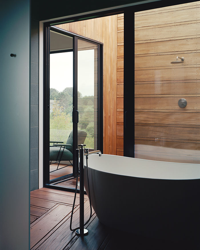 Master suite bathroom that leads to an open-air shower