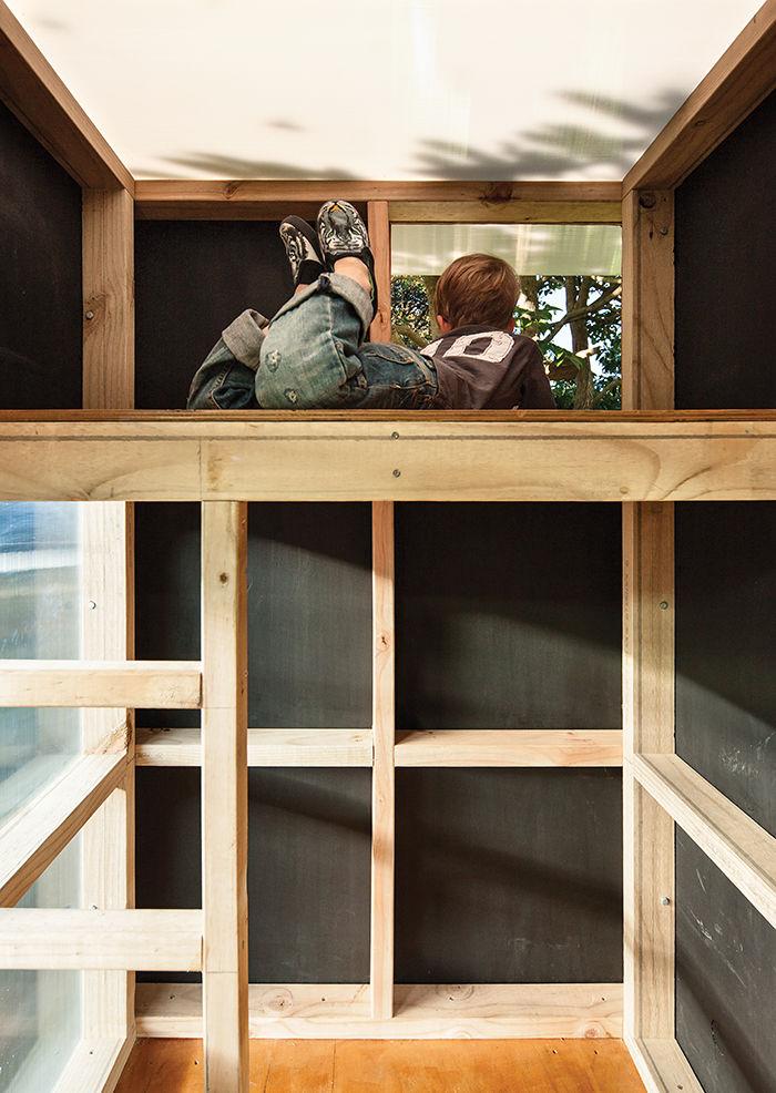 Backyard playhouse with an interior sleeping nook