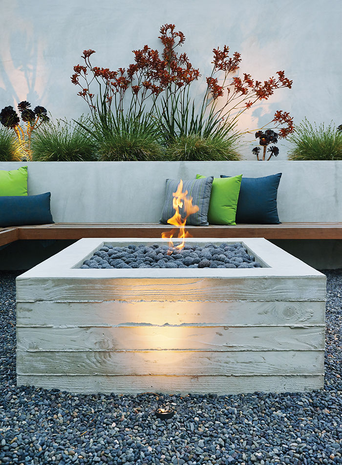 Wooden bench and fire pit in backyard
